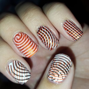 Lots of stripes for today's Halloween nail art challenge day 28 prompt is guess what stripes!  using @bornprettystore #stampingplates @sinfulcolors_official #halloween #halloweennails #blogger #nailpolish #notd #nailartchallenge #nailsofinstagram #nailstagram #nails4yummies #newstuff #nails #love #naildesigns #nailartsupplies #nailartproducts #nailartstamping #stampingnails #nailartaddict #avon #rimmel #rimmellondon @essence_cosmetics #nailartcommunity #nailartclub #nailsoftheday #nailswag #stripednails
